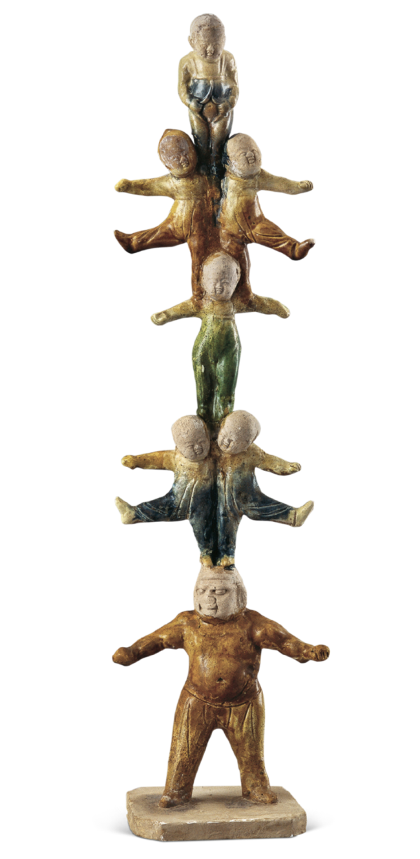 三彩童子叠置技俑,唐,通高 40.8 厘米,2002 年西安市长安区郭杜镇唐墓出土,西安博物院藏
