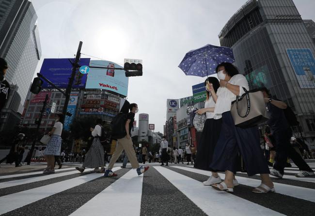 日本疫情告急病床紧缺近10万新冠患者被迫在家疗养
